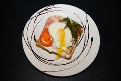 Sandwich with fried egg and vegetables stock images