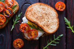 Sandwich with fried eggs and with fried cherry tomatoes Royalty Free Stock Images