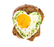 Sandwich with fried eggs in the shape of a heart Royalty Free Stock Images