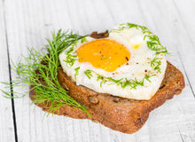Sandwich with fried eggs in the shape of a heart Stock Photo