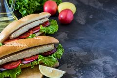 Sandwich with fried fish and vegetables. Balik ekmek - turkish f Stock Photo