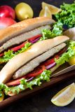 Sandwich with fried fish and vegetables. Balik ekmek - turkish f Royalty Free Stock Photography