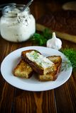 Sandwich of fried toasts with garlic melted cheese Royalty Free Stock Image