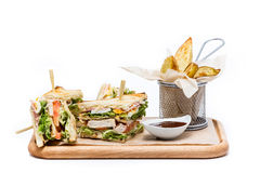 Sandwich with fries. Tasty sandwich with french fries Royalty Free Stock Images