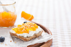 Sandwich with fruit jam and cottage cheese on a board Royalty Free Stock Photography