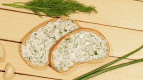 A sandwich with garlic sauce. On wooden background stock video
