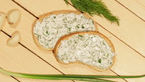 A sandwich with garlic sauce. On wooden background stock footage