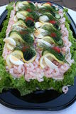 Sandwich gateau with seafood. Sandwich gateau with shrimps, caviar, tuna, egg vegetables and bread Stock Image