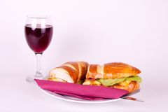 Sandwich and glass of wine. Delicius sandwich with set for dining, and glass of wine Royalty Free Stock Image