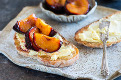 Sandwich with goat cheese, baked plum and honey Stock Photography
