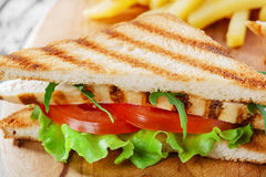 Sandwich with grilled chicken and tomatoes Royalty Free Stock Photo