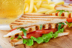 Sandwich with grilled chicken and tomatoes Stock Images