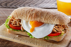 Sandwich with grilled meat egg tomato salad ciabatta Stock Photos