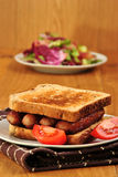 Sandwich with grilled sausages and tomato Stock Photo