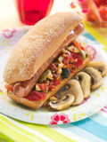 Sandwich with grilled vegetables and sausage Stock Image