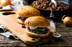Sandwich with ground  beef and onion. Sandwich with ground beef and onion. style rustic. selective focus Stock Image