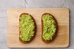 Sandwich with guacamole on light background. breakfast concept royalty free stock photography