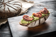 Sandwich with guacamole and sun-dried tomatoes Royalty Free Stock Photo