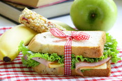 Sandwich with ham, apple, banana and granola bar Stock Image