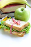 Sandwich with ham, apple, banana and granola bar Stock Photography
