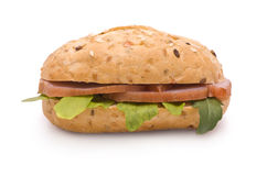 Sandwich with Ham and Arugula. On white Royalty Free Stock Photo