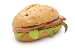 Sandwich with Ham and Arugula. On white Royalty Free Stock Image