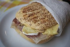 Sandwich with ham and brie. Served in Italy Stock Images
