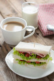 Sandwich ham with cheese, coffee and milk on wood table. Royalty Free Stock Photography