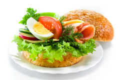 Sandwich with ham, cheese, fresh vegetables and egg Stock Images
