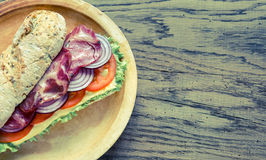Sandwich with ham, cheese and fresh vegetables Royalty Free Stock Images