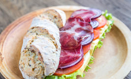 Sandwich with ham, cheese and fresh vegetables Royalty Free Stock Image