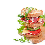 Sandwich with ham, cheese and fresh vegetables Royalty Free Stock Photos