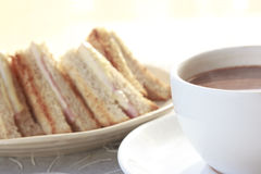 Sandwich ham cheese with hot chocolate Stock Image