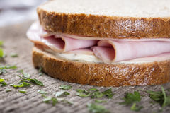 Sandwich with ham and cheese. Over wooden background Stock Photos