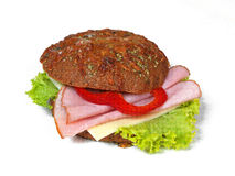 Sandwich with ham,cheese and red paprika. Sandwich with ham,cheese, salad and red paprika on a White background Stock Image