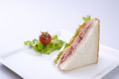 Sandwich. Ham and cheese sandwich with tomato and lettuce Royalty Free Stock Images