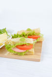 Sandwich with ham, cheese and vegetables. Royalty Free Stock Photo