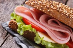 Sandwich with ham, cheese and vegetables close up Stock Image