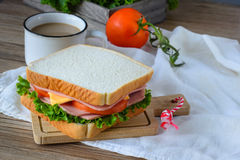 Sandwich with ham, cheese and vegetables and hot coffee on wood table Royalty Free Stock Photography