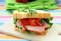 Sandwich with ham and fresh vegetables Stock Photo