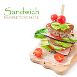 Sandwich with ham and fresh vegetables Stock Image
