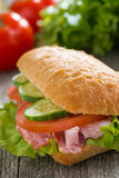 Sandwich with ham and fresh vegetables, selective focus Royalty Free Stock Image