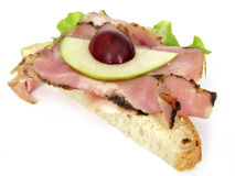 Sandwich with ham and fruit. Sandwich isolated on white background stock images