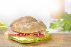 Sandwich with ham and green lettuce and cheese. Sandwich with ham,  cheese and green lettuce on white background Stock Photos