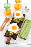 Sandwich with ham, lettuce and a fried egg. Breakfast. Royalty Free Stock Photo