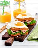 Sandwich with ham, lettuce and a fried egg. Breakfast. Stock Photography