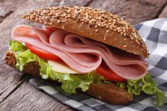 Sandwich with ham, lettuce and tomatoes on an old table Royalty Free Stock Photography