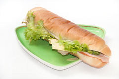 Sandwich with ham and letuce on the green plate Royalty Free Stock Photography