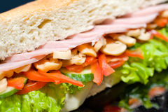 Sandwich with ham and mushrooms, macro Royalty Free Stock Image