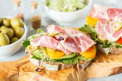 Sandwich with ham, olives, rye bread and vegetables Royalty Free Stock Photo